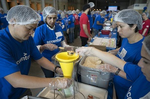 Accenture employees box 15,200 pounds of hunger relief packages, for a total of 100,000 meals donated by the company to the Daily Bread Food Bank during Accenture's annual employee meeting in Toronto, Ont., Friday, June 16, 2017.  The Canadian Press Images PHOTO/Accenture