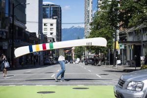 Olympian Conlin McCabe carries Hudson's Bay's iconic canoe through the streets of Vancouver to help kick off the Grand Portage on Thursday, June 22, 2017.  The Grand Portage is a fundraising initiative developed by Hudson's Bay in support of Trans Canada Trail, designed to help connect the remaining 2,200 kms of The Great Trail in celebration of Canada's 150th Birthday.  The Canadian Press Images PHOTO/Hudson's Bay