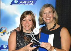 Sophie Lessard, Regional Sales Manager for the Sunwing Travel Group in Quebec and Marie-Josée Carrière, Marketing Manager, accepting the award.