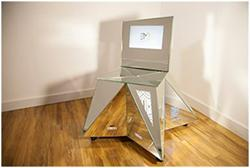 Winner of the People's Choice Art of Design Competition -- The artistic and high technology chair designed by Steelman Partners and built by Electric Mirror.
