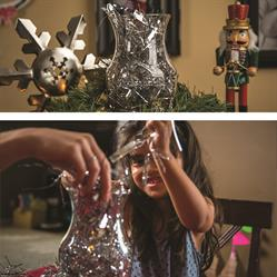 Give your holiday decor a second life -- fill a vase or hurricane with sparkly tinsel leftovers that may have fallen to the floor and use it as a festive holiday centerpiece.