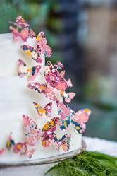 Wedding cake decorated with die-cut chiyogami washi paper butterflies
