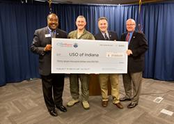 Carl Huber, WaterFurnace vice president of corporate quality, presented the check during an Oct. 30 news conference at the company's corporate headquarters in Fort Wayne, Ind. From left to right: Jim Pridgin of the USO, Col. Patrick Renwick of the 122nd Fighter Wing, Charles Ridings of the USO, and Bob Legacy of the USO.