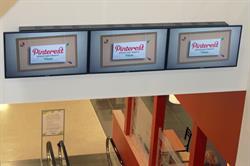 Video Walls above the escalators at Nebraska Furniture Mart