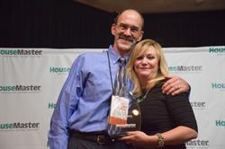 HouseMaster President, Kathleen Kuhn presenting to HouseMaster Franchise Owner, Nick Henry.
