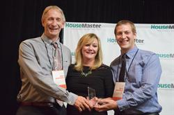 HouseMaster President, Kathleen Kuhn with Mike and Drew Kauffman, Franchise Owners.