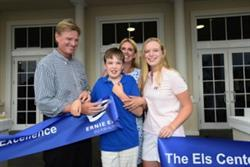 Professional golfer Ernie Els, his wife Liezl, son Ben and daughter Samantha, pose with the ribbon during the Els Center of Excellence Grand Opening Ceremony in August 2015. The Els Center of Excellence is a project of the Els for Autism Foundation.