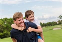 Professional golfer Ernie Els pictured with his son, Ben. Els and his wife Liezl established the Els for Autism Foundation in 2009 shortly after Ben (now 13) was diagnosed with autism.