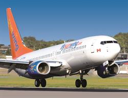 A Sunwing Airlines plane takes off