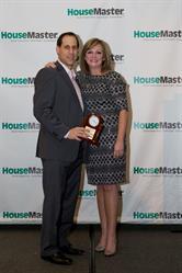Franchise Owner Matt Kaplan Receiving Home Inspection Excellence Award.