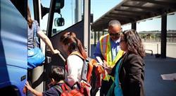 Passengers boarding a Jefferson Lines bus