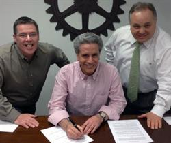 Mr. Canet, Dr. Cellucci and Mr. Vento executing DCI's acquisition of Viking Telecom
