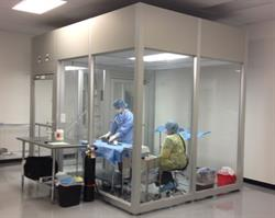 Technicians prepare cornea tissue for transplant in the annex clean room.