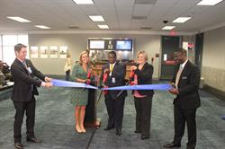 Reese McCrannie, Maggie Valz, Michael Smith, Michele Olson, and Martin Humphrey cut the ribbon at the inaugural celebration.