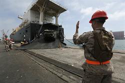 U.S. Marine Corps Sgt. Chaz A. Campbell, right, amphibious assault vehicle (AAV) section leader, 2nd Assault Amphibian Battalion, 2nd Marine Division, currently augmented to 2nd Marine Expeditionary Brigade, guides an AAV off of USNS 1st Lt. Jack Lummus, a cargo ship with Military Sealift Command, in preparation for Exercise African Lion 15 at the port of Agadir, Morocco, May 7, 2015. (U.S. Marine Corps photo by Lance Cpl. Kelly L. Street, 2D MARDIV COMCAM/Released)