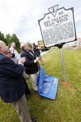 Allan Jones unveils commemorative Thaxton marker.