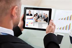 Business Man Watching Webinar on Tablet