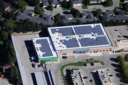 An aerial photo of a StorageMart Self-Storage facility in London, Ontario; one of PowerStream's fourteen roof-top solar PV generation projects.