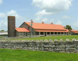 Equestrian Center stables and silo at Riverbend Farm.