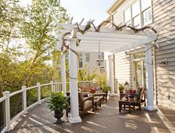 A Trex Pergola and comfortable furniture help create the perfect spot to relax or have small gatherings with friends.