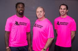 "Baltimore Ravens C.J. Mosley, WWE Hall of Famer Bret ""Hitman"" Hart and Managing Partner Paul Pitcher"