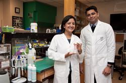 Oral Antibiotics Inc. co-founders Dr. Annie Shrestha and Prof. Anil Kishen in their lab at the University of Toronto.
