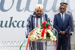 Morocco's King Mohammed VI lays a wreath at the Kigali Genocide Memorial in Rwanda. The leader traveled to Rwanda and Tanzania this month.
