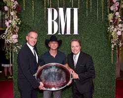 BMI President & CEO Mike O'Neill and BMI Vice President, Writer/Publisher Relations Jody Williams pose with 2016 President's Award recipient Kenny Chesney. Pictured L to R: O'Neill, Chesney, Williams