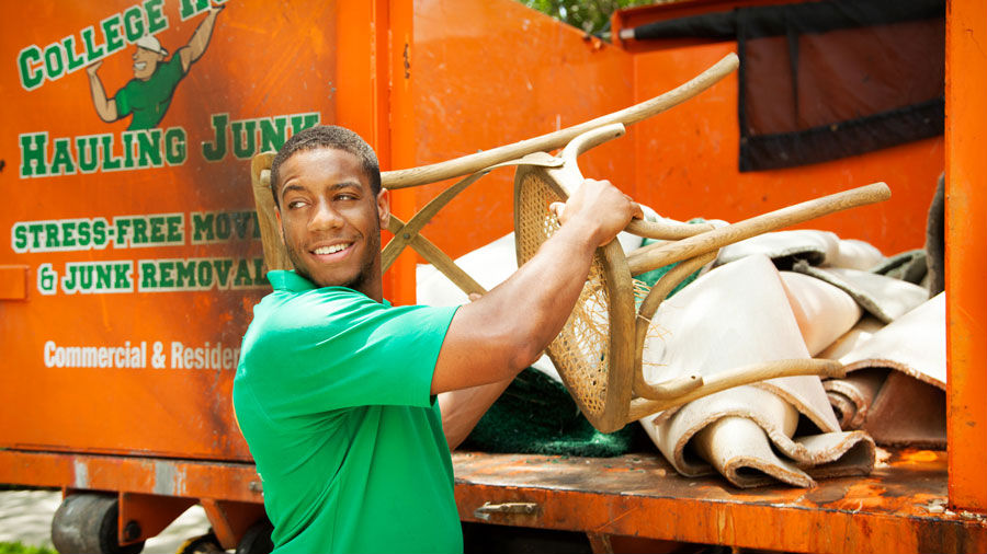 College Hunk loading junk into a CHHJ truck