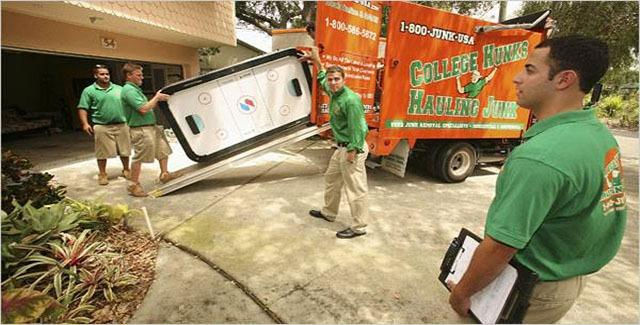 Four College Hunks moving a large item