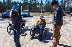 Ellerbe Kinard talks with an injured veteran.