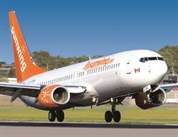 Sunwing Airlines taking off from tarmac.