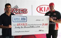 DMV.ORG presents the $25,000 check to B.R.A.K.E.S.