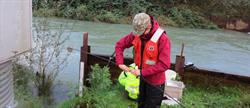 User Experience Designer, Jacqueline Gullion, out in the field conducting water quality sampling.