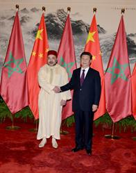 Morocco's King Mohammed VI meets with President of the People's Republic of China Xi Jinping in Beijing on May 11, 2016.