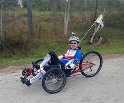 Brian Steere on his recumbent bicycle in 2015.