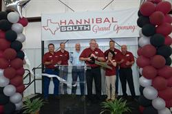 Hannibal Industries' leadership pictured from left to right: Plant Manager Oscar Alarcon, Regional Sales Director Ryan Peck, VP Material & Logistics Sean Carroll, President Blanton Bartlett (cutting ribbon with scissors), Regional Sales Director Gary Steen, Vice President Finance Heidy Moon, Engineering Manager Senad Dzaferovic, Executive Vice President Steve Rogers.