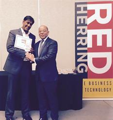Farsight Security Vice President Marketing, Nilesh Bhandari, accepts the 2016 Red Herring Top 100 North America Award for the company from Alex Vieux, publisher and CEO of Red Herring, at a special awards ceremony in Newport Beach, California.