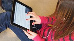 Girl reading digital book on electronic device