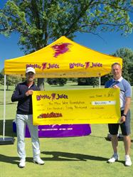 London, Ontario - Dale Wishewan, President and CEO of Booster Juice presenting a donation cheque to Mike Weir (left) for his Foundation at the Mike Weir Miracle Golf Drive For Kids on June 6, 2016