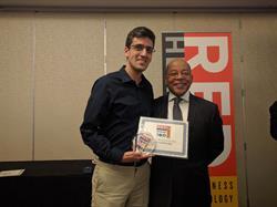 ConvertMedia CEO Yoav Naveh accepts Red Herring Top 100 Award
