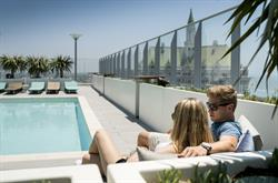 The Current's resort inspired rooftop pool offers seaside vistas