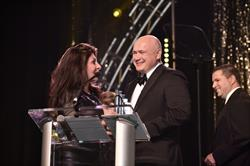 Sergey Gorlov of Petrosoft speaks with Comedian Tammy Pescatelli while accepting the Ernst & Young (EY) Entrepreneur Of The Year(R) 2016 Award in the technology software category in the Western Pennsylvania and West Virginia program.