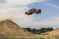 Off-road racer Bryce Menzies jumps his 900 horsepower Pro2 truck during training.  On August 27, he will attempt to break the 332 ft. truck distance record by jumping over a ghost town.