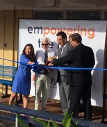 April Zhong, John Harpootlian, Matt Komar and Father John Poncini cut the ribbon