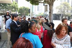 LCA Founder Chris DeRose (in sunglasses) addressing a crowd of protesters with Lee Key-Cheol, Consul General of the Republic of Korea