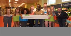 IFE/KickinNutrition.TV Team at Whole Foods Somerville Store for 5% Day Check Presentation. (Left to right) WFM Marketing Specialist, Dena Cherenson; IFE Intern, Caroline Morant; IFE Co-Host/Actor, Simone Senibaldi; IFE Program Director, Jamie Klufts; WFM Associate Store Team Leader, Amule Sam; IFE Intern, Harry Nichols; IFE Intern Tatyana Kurepina; IFE President/Founder Natasha Lance Rogoff; WFM Marketing/Community Liaison Manager, Matt Keller.