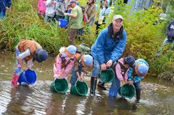 World Rivers Day Chair Mark Angelo and school children release trout into a local stream