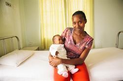 A mother and child at a Jacaranda Health facility. Photo credit: Jacaranda Health.