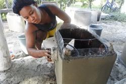 Constructing a SOIL household EkoLakay toilet. Photo credit - SOIL Haiti / Jamie Lloyd.